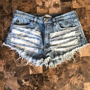 Distressed KanCan shorts with patchwork